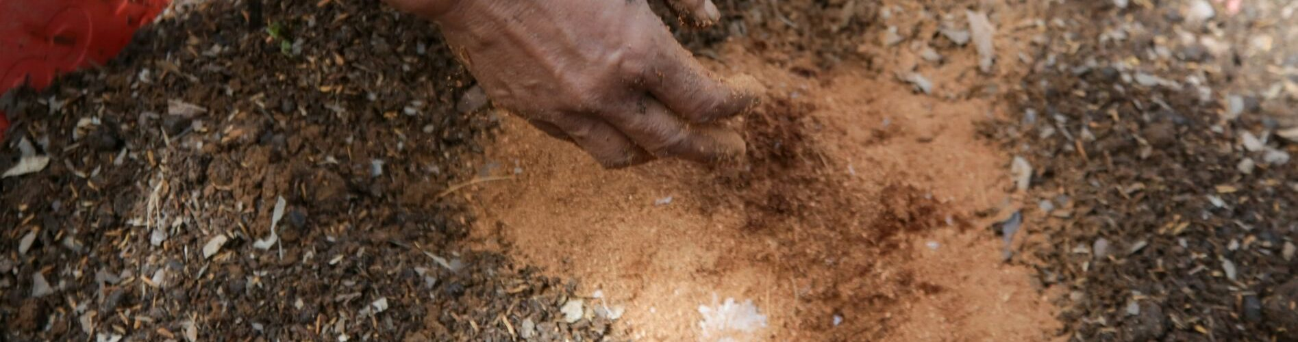 Hands over soil mixing in soil amendments for better soil quality