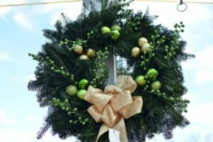 decorated cedar wreath with gold ribbon