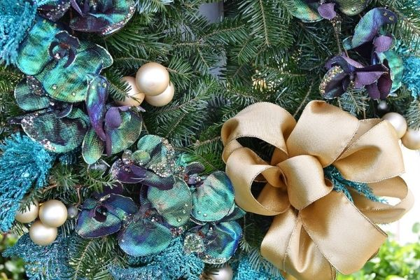 blue and gold ribbons on wreath