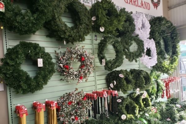 wall of artificial wreaths in many sizes
