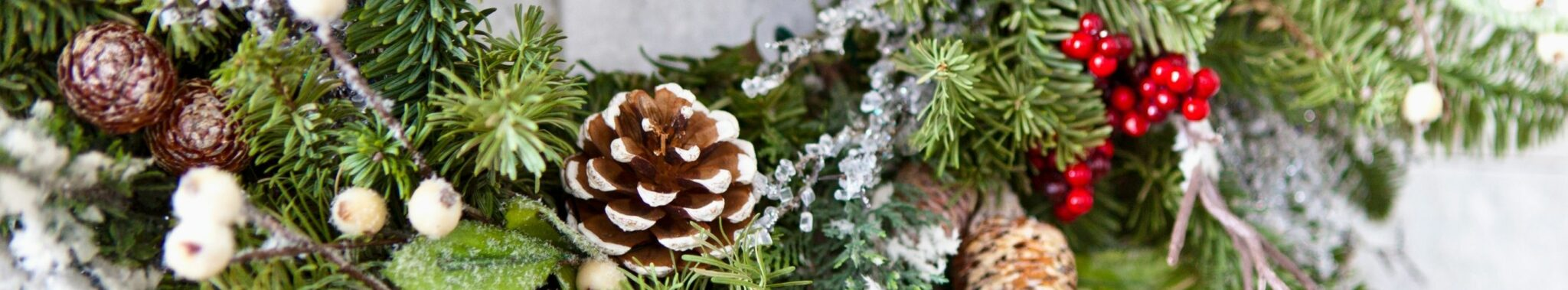 christmas wreath with decorations on door